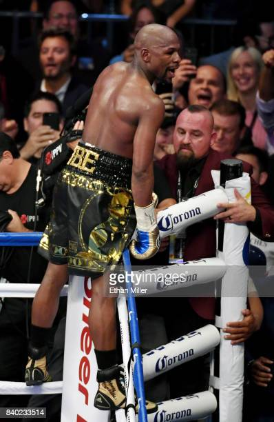 Floyd Mayweather Jr celebrates his 10thround TKO of Conor McGregor to win their super welterweight boxing match at TMobile Arena on August 26 2017 in...