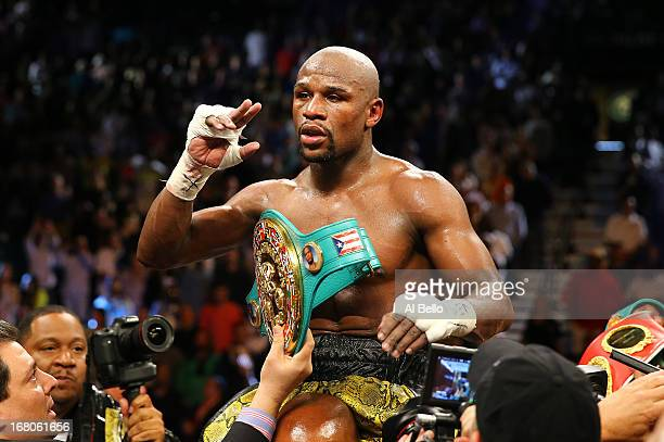 Floyd Mayweather Jr celebrates his unanimousdecision victory over Robert Guerrero in their WBC welterweight title bout at the MGM Grand Garden Arena...