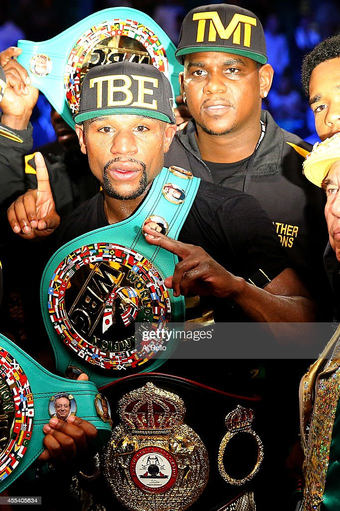Floyd Mayweather Jr. celebrates his unanimous-decision victory over Marcos Maidana during their WBC/WBA welterweight title fight at the MGM Grand Garden Arena on September 13, 2014 in Las Vegas, Nevada.