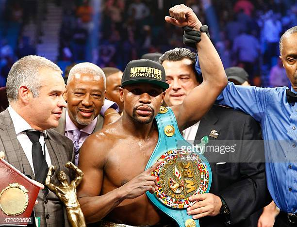 Floyd Mayweather Jr. Celebrates the unanimous decision victory during the welterweight unification championship bout on May 2, 2015 at MGM Grand...
