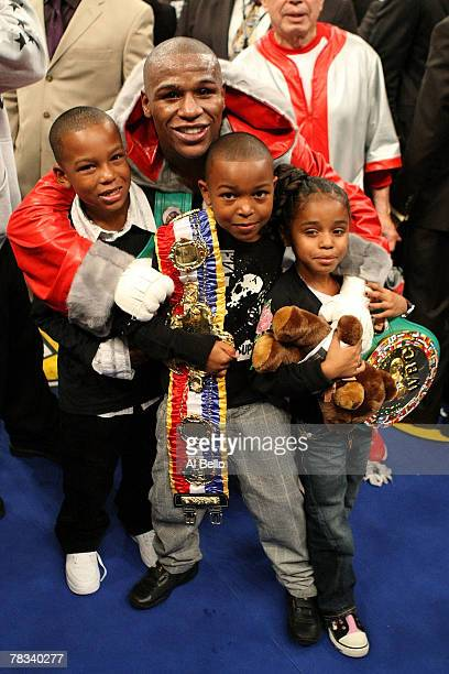 Floyd Mayweather Jr celebrates with his children Shamaree Mayweahter Koraun Mayweather and Iyanna Mayweather after his 10th round knockout of Ricky...