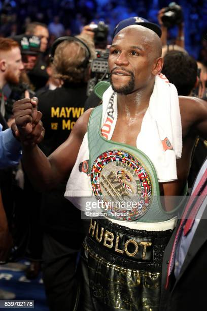Floyd Mayweather Jr. Celebrates with the WBC Money Belt after his TKO of Conor McGregor in their super welterweight boxing match on August 26, 2017...