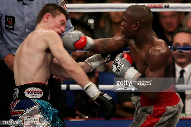 Floyd Mayweather Jr connects with a right in the 10th round to the body of Ricky Hatton of England during their WBC world welterweight championship...