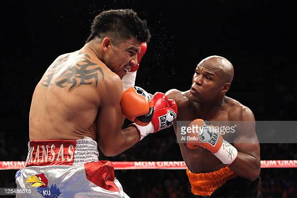 Floyd Mayweather Jr connects with a right to the face of Victor Ortiz during their WBC welterweight title fight at the MGM Grand Garden Arena on...