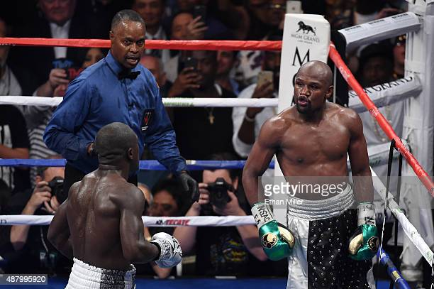Floyd Mayweather Jr dances around the ring in the final round against Andre Berto during their WBC/WBA welterweight title fight at MGM Grand Garden...