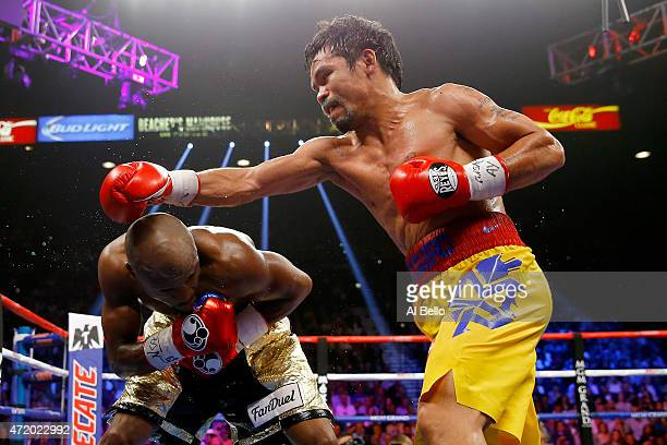 Floyd Mayweather Jr ducks as Manny Pacquiao throws a right during their welterweight unification championship bout on May 2 2015 at MGM Grand Garden...