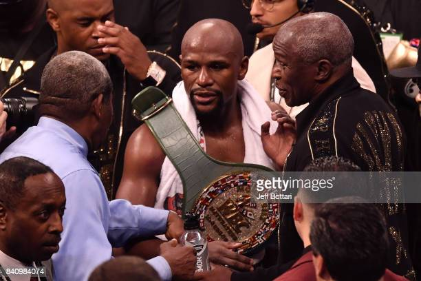 Floyd Mayweather Jr embraces his father Floyd Mayweather Sr after defeating Conor McGregor in their super welterweight boxing match at TMobile Arena...