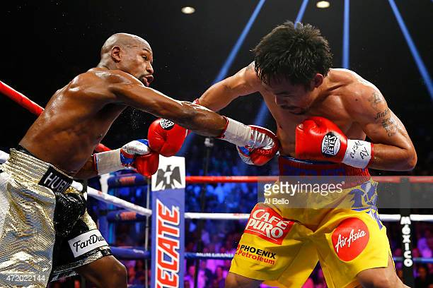 Floyd Mayweather Jr exchange punches with Manny Pacquiao during their welterweight unification championship bout on May 2 2015 at MGM Grand Garden...