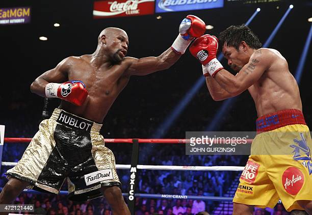 Floyd Mayweather Jr exchange punches with Manny Pacquiao during their welterweight unification championship bout May 2 2015 at MGM Grand Garden Arena...