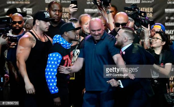 TOPSHOT Floyd Mayweather Jr faces off for the first time with UFC fighter Conor McGregor during a press call at the Staples Center in Los Angeles...