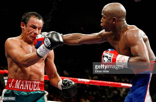 Floyd Mayweather Jr hits Juan Manuel Marquez in the eighth round of their fight at the MGM Grand Garden Arena September 19 2009 in Las Vegas Nevada...