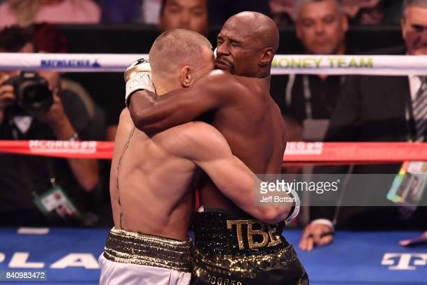 Floyd Mayweather Jr holds Conor McGregor in their super welterweight boxing match at TMobile Arena on August 26 2017 in Las Vegas Nevada Mayweather...