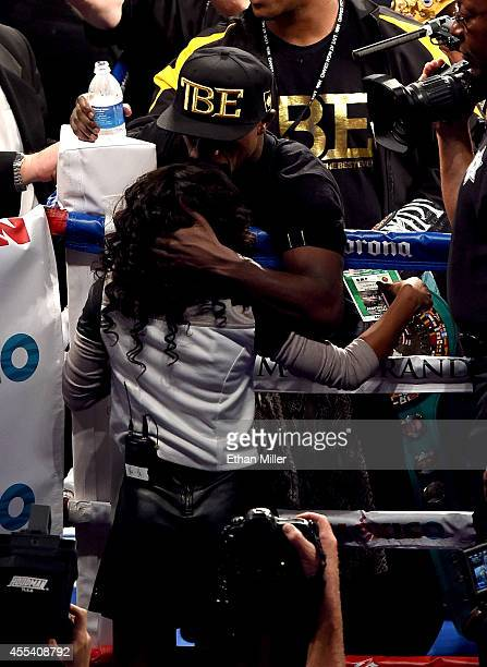 Floyd Mayweather Jr hugs his daughter Iyanna Mayweather after his unanimousdecision victory against Marcos Maidana during their WBC/WBA welterweight...