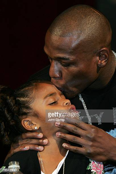 Floyd Mayweather Jr kisses his daughter Iyanna Mayweather during his post fight news conference after knocking out Ricky Hatton of England in the...