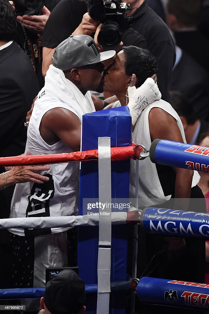 Floyd Mayweather Jr. kisses his mother Deborah Sinclair after defeating Andre Berto in their WBC/WBA welterweight title fight at MGM Grand Garden Arena on September 12, 2015 in Las Vegas, Nevada.