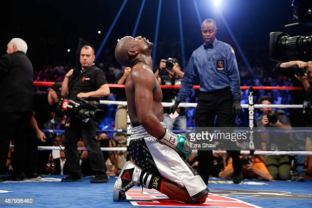 Floyd Mayweather Jr. Kneels on the mat after winning his WBC/WBA welterweight title fight against Andre Berto at MGM Grand Garden Arena on September...