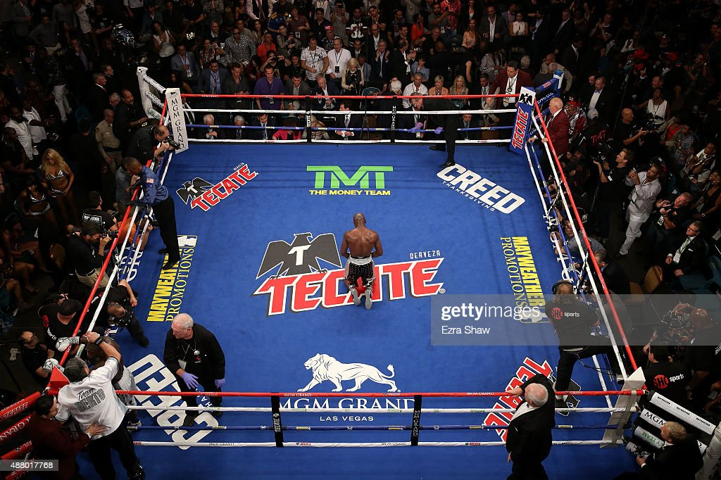 Floyd Mayweather Jr. kneels on the mat after winning his WBC/WBA welterweight title fight against Andre Berto at MGM Grand Garden Arena on September 12, 2015 in Las Vegas, Nevada. Mayweather won the fight by unanimous decision.