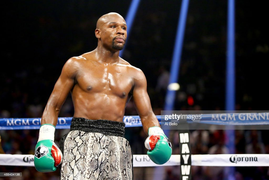 Floyd Mayweather Jr. looks on while taking on Marcos Maidana during their WBC/WBA welterweight title fight at the MGM Grand Garden Arena on September 13, 2014 in Las Vegas, Nevada.