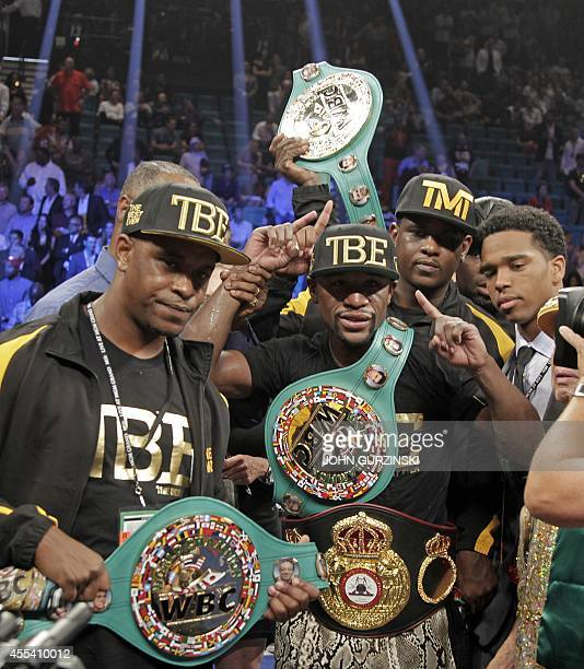 Floyd Mayweather Jr of the US poses with his belts after beating Marcos Maidana of Argentina on September 13 2014 at The MGM Grand Las Vegas...