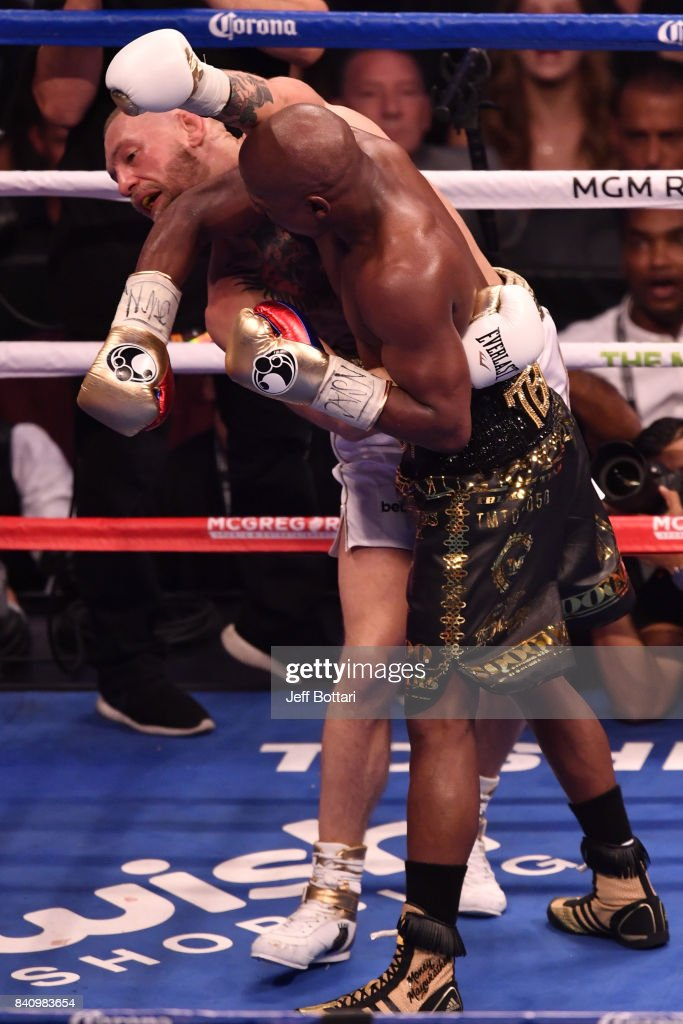 Floyd Mayweather Jr. pushes Conor McGregor with his forearm in their super welterweight boxing match at T-Mobile Arena on August 26, 2017 in Las Vegas, Nevada. Mayweather won by 10th-round TKO.