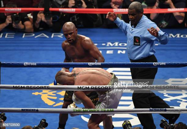 Floyd Mayweather Jr reacts as referee Robert Byrd stops his super welterweight boxing match against Conor McGregor to give Mayweather a 10thround TKO...
