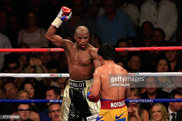 Floyd Mayweather Jr reacts in the 12th round during the welterweight unification championship bout on May 2 2015 at MGM Grand Garden Arena in Las...