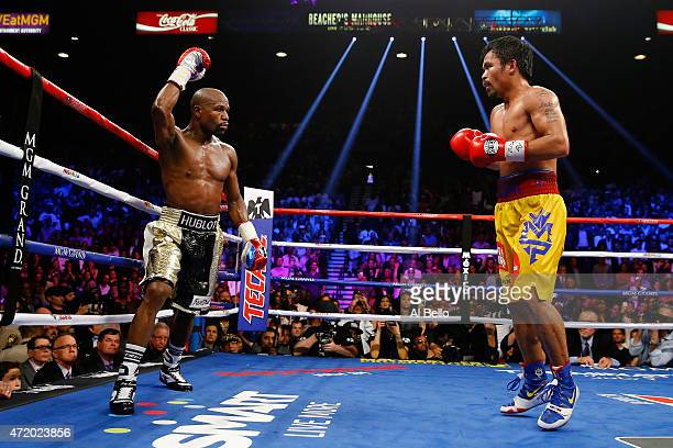Floyd Mayweather Jr reacts in the twelfth round during the welterweight unification championship bout on May 2 2015 at MGM Grand Garden Arena in Las...