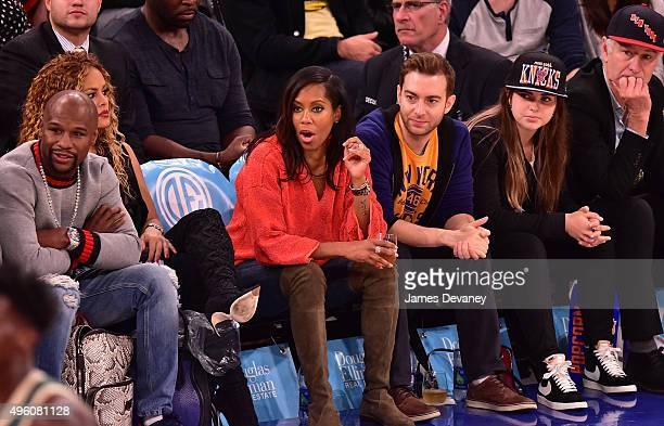 Floyd Mayweather Jr Regina King guest Emily McEnroe and John McEnroe attend New York Knicks vs Milwaukee Bucks game at Madison Square Garden on...