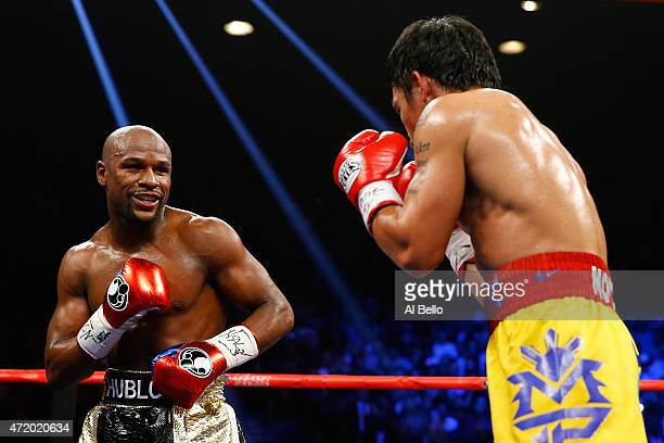 Floyd Mayweather Jr. Smiles at Manny Pacquiao during their welterweight unification championship bout on May 2, 2015 at MGM Grand Garden Arena in Las...