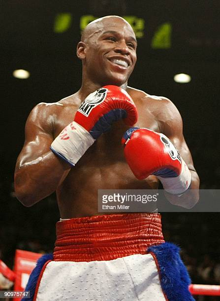 Floyd Mayweather Jr smiles during his fight against Juan Manuel Marquez of Mexico during their welterweight bout at the MGM Grand Garden Arena...