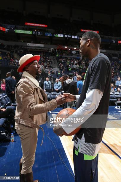 Floyd Mayweather Jr speaks to Jamal Crawford of the Minnesota Timberwolves before the game against the New Orleans Pelicans on February 3 2018 at...