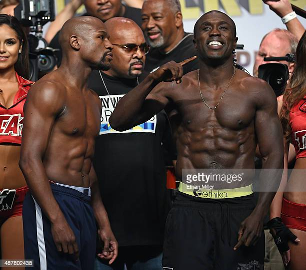 Floyd Mayweather Jr stares at Andre Berto as they pose during their official weighin at MGM Grand Garden Arena on September 11 2015 in Las Vegas...