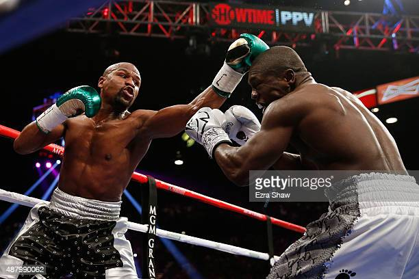 Floyd Mayweather Jr throws a left at Andre Berto during their WBC/WBA welterweight title fight at MGM Grand Garden Arena on September 12 2015 in Las...