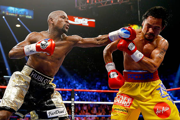 Floyd Mayweather Jr. Throws a left at Manny Pacquiao during their welterweight unification championship bout on May 2, 2015 at MGM Grand Garden Arena...