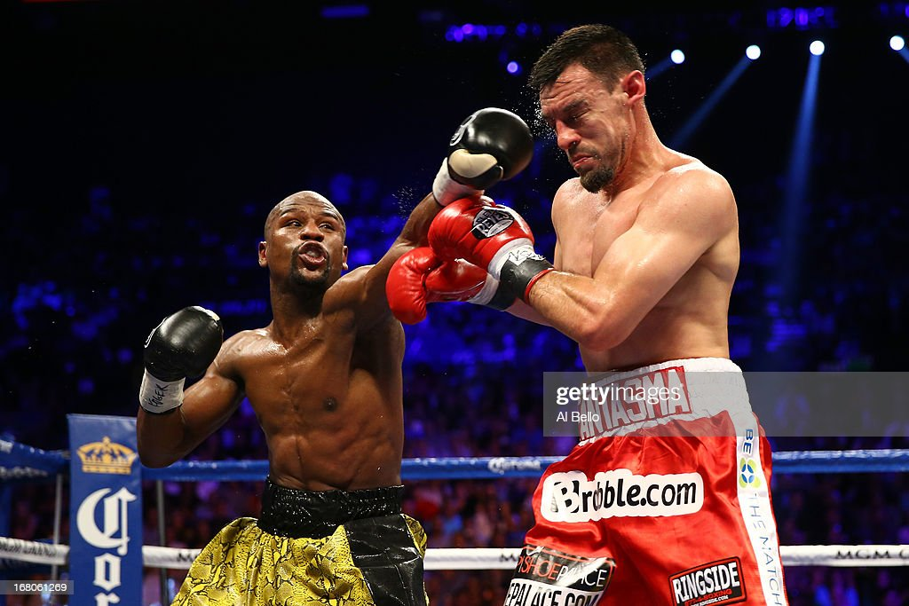 Floyd Mayweather Jr. throws a left to the face of Robert Guerrero in their WBC welterweight title bout at the MGM Grand Garden Arena on May 4, 2013 in Las Vegas, Nevada.