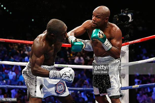 Floyd Mayweather Jr throws a right at Andre Berto during their WBC/WBA welterweight title fight at MGM Grand Garden Arena on September 12 2015 in Las...