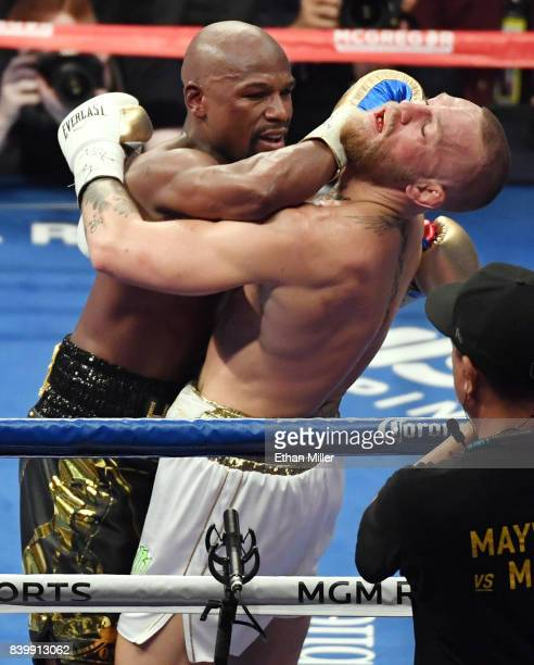Floyd Mayweather Jr throws a right at Conor McGregor in the seventh round of their super welterweight boxing match at TMobile Arena on August 26 2017...