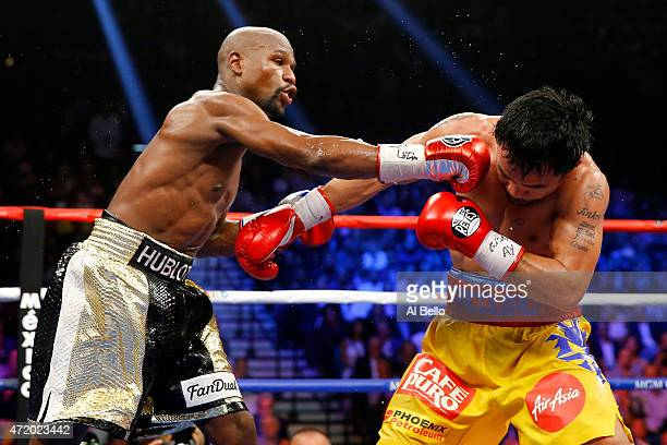 Floyd Mayweather Jr throws a right at Manny Pacquiao during their welterweight unification championship bout on May 2 2015 at MGM Grand Garden Arena...