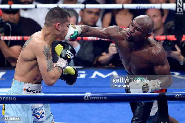 Floyd Mayweather Jr throws a right at Marcos Maidana during their WBC/WBA welterweight unification fight at the MGM Grand Garden Arena on May 3 2014...