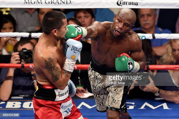 Floyd Mayweather Jr throws a right to the face of Marcos Maidana during their WBC/WBA welterweight title fight at the MGM Grand Garden Arena on...