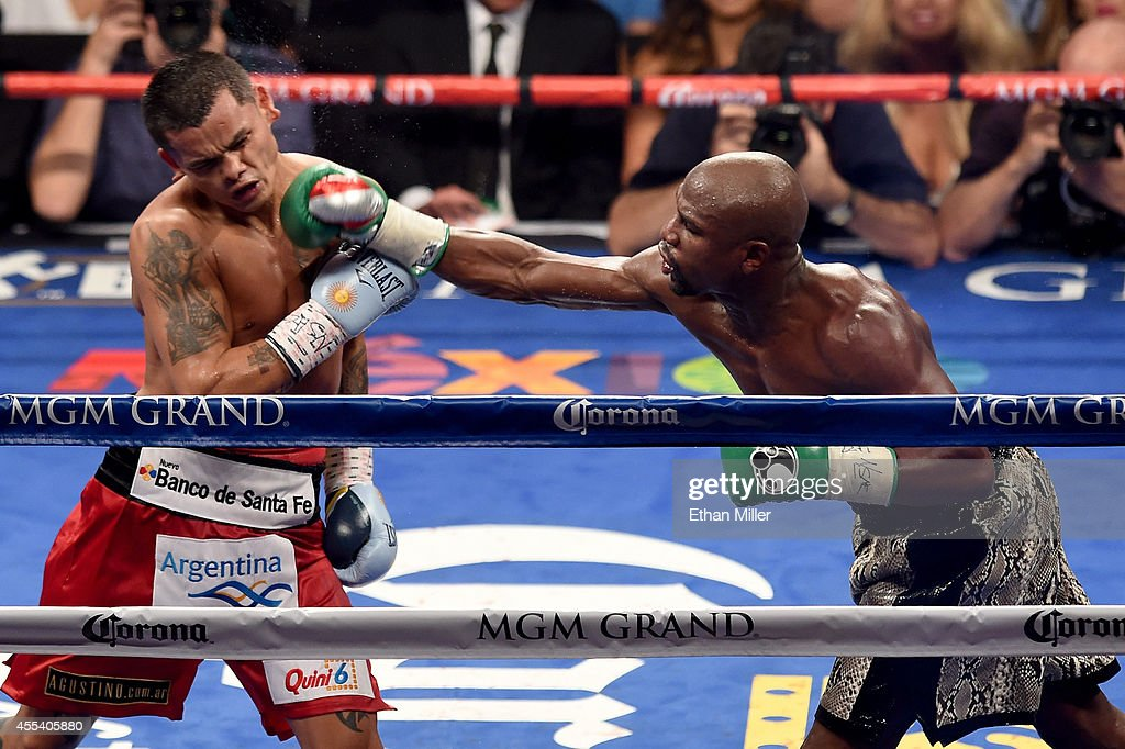Floyd Mayweather Jr. throws a right to the face of Marcos Maidana during their WBC/WBA welterweight title fight at the MGM Grand Garden Arena on September 13, 2014 in Las Vegas, Nevada.