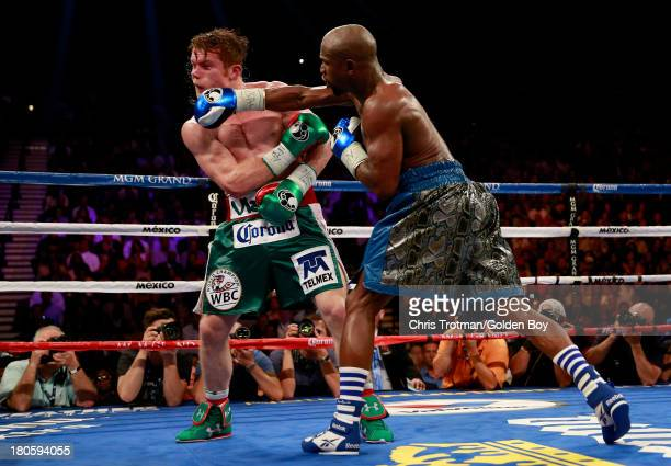 Floyd Mayweather Jr. Throws a right to the head of Canelo Alvarez during their WBC/WBA 154-pound title fight at the MGM Grand Garden Arena on...