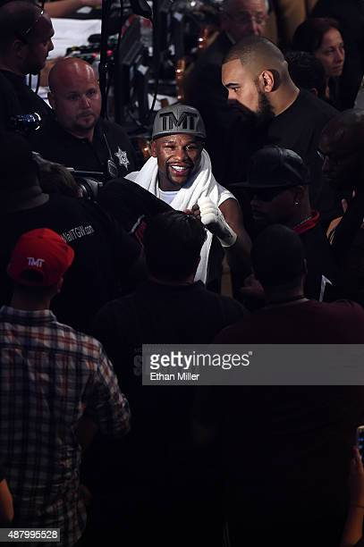 Floyd Mayweather Jr walks out of the arena after his unanimousdecision win over Andre Berto in their WBC/WBA welterweight title fight at MGM Grand...