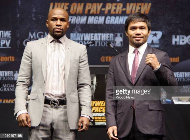 Floyd Mayweather of the United States and Manny Pacquiao of the Philippines pose for a photo in Los Angeles on March 11 during a press conference to...