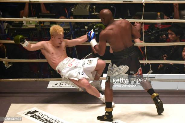 Floyd Mayweather of the United States knocks down Tenshin Nasukawa of Japa during the RIZIN. 14 at Saitama Super Arena on December 31, 2018 in...