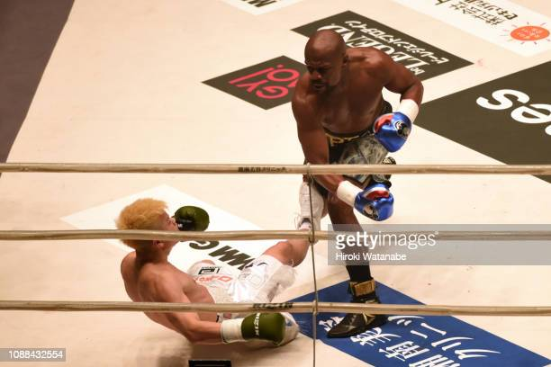 Floyd Mayweather of the United States knocks down Tenshin Nasukawa of Japan during the RIZIN 14 at Saitama Super Arena on December 31 2018 in Saitama...