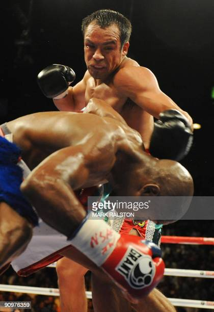 Floyd Mayweather of the US ducks a punch by Juan Manuel Marquez of Mexico in their Welterweight fight at the MGM Grand Garden Arena September 19,...