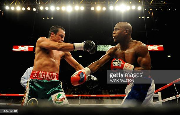 Floyd Mayweather of the US lands a punch on Juan Manuel Marquez of Mexico in their Welterweight fight at the MGM Grand Garden Arena September 19,...