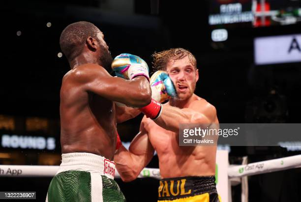 Floyd Mayweather punches Logan Paul during their contracted exhibition boxing match at Hard Rock Stadium on June 06, 2021 in Miami Gardens, Florida.
