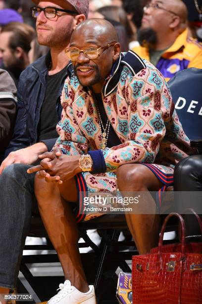 Floyd Mayweather sits courtside during the Los Angeles Lakers vs Golden State Warriors game/Kobe Bryant jersey retirement ceremony on December 18...